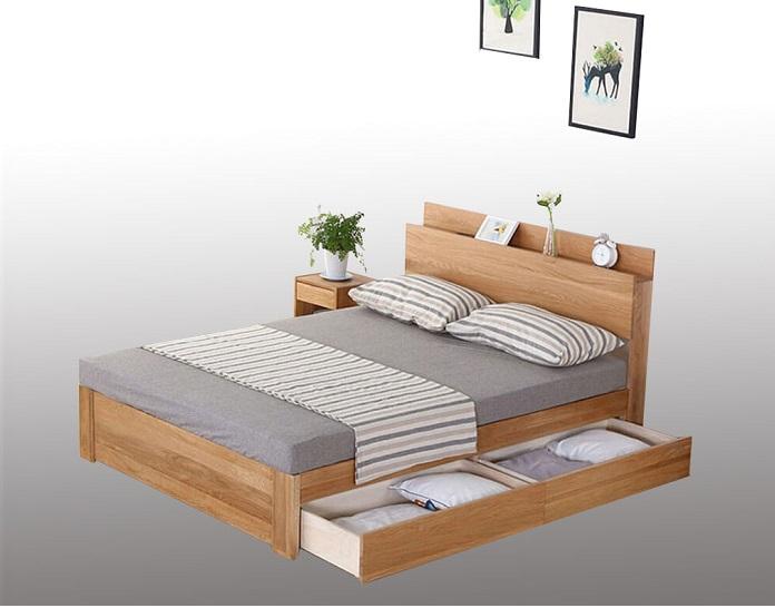 Giường Gỗ 2mx2m – Mẫu 2M-34: có chỗ để đồ nhỏ đầu giường và ngăn kéo đựng đồ lớn tiện dụng.