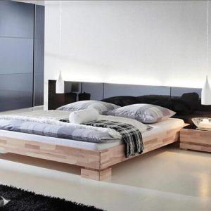 Giường gỗ 2m x 2m2 gầm thấp giúp tạo cảm giác rộng rãi và thoải mái