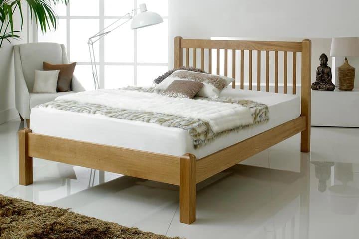 Giường gỗ ép đơn giản